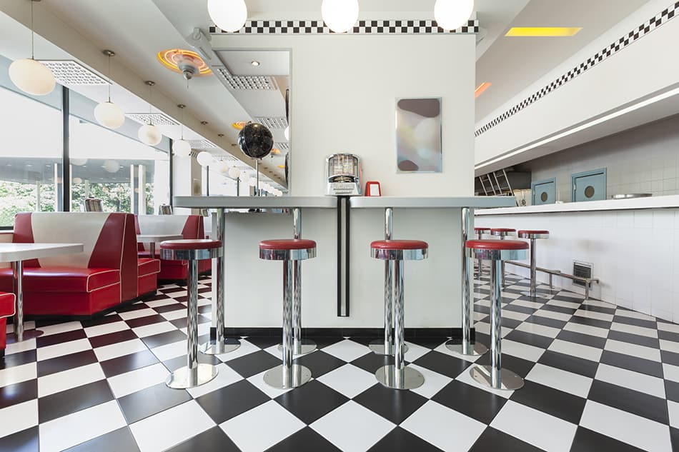 Bar Stools in an American diner restaurant on a checkerboard floor