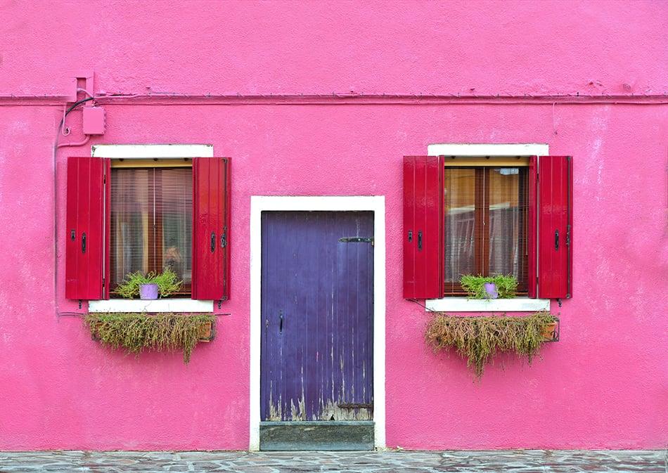 Rustic Wooden Purple Door with Red Shutters
