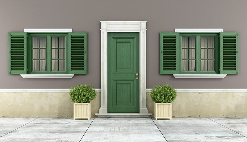 Classic Cottage with Green Door and Window Shutters