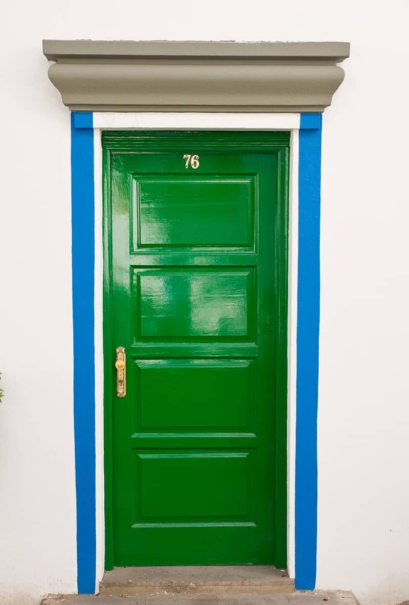 Green Door with Blue and Gray Siding