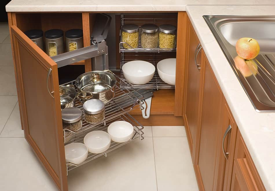 A metal organizer attached to the cabinet