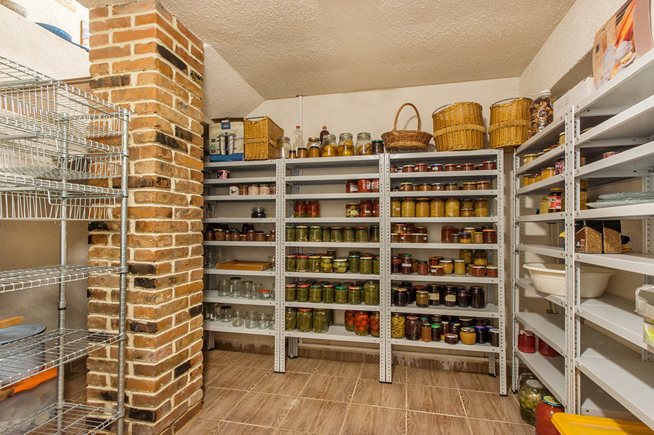 A pantry for storing various jars food