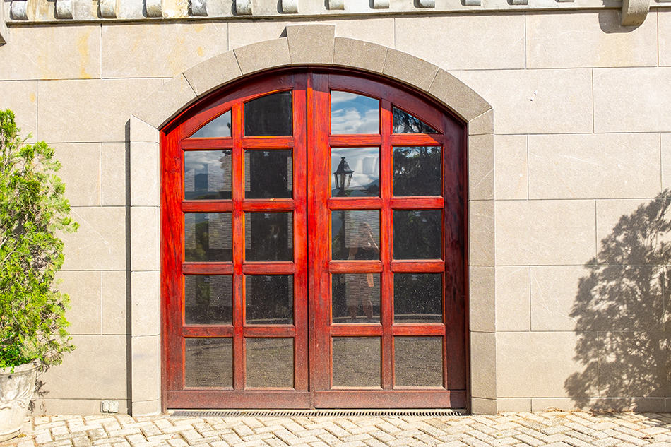 Dash of Red on Double Glass Doors