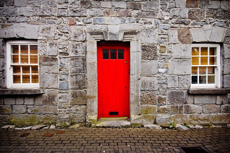 Red Door on Stone Exterior