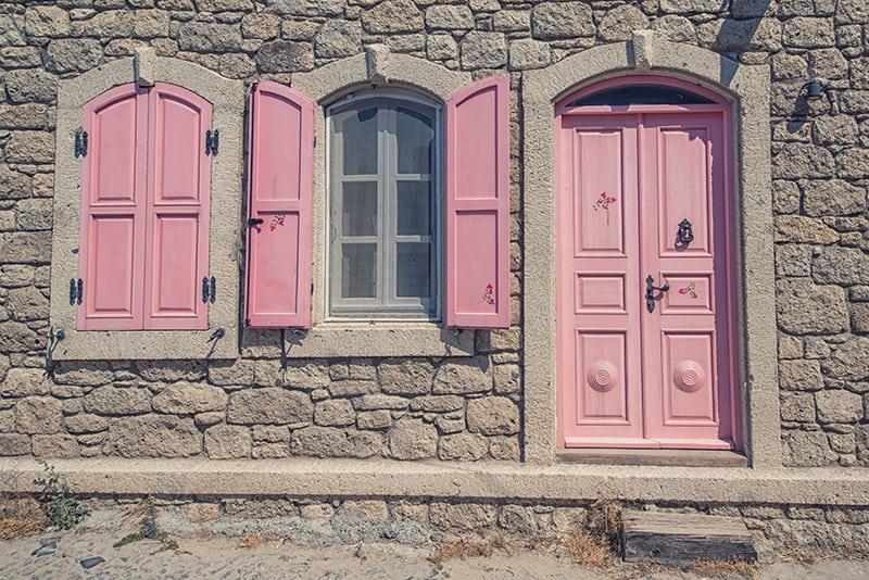Vintage Pink Wooden Door on Stone