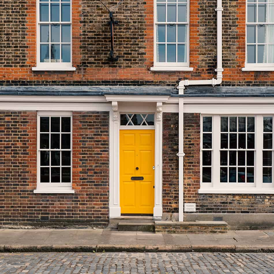Yellow Door on a Brick House