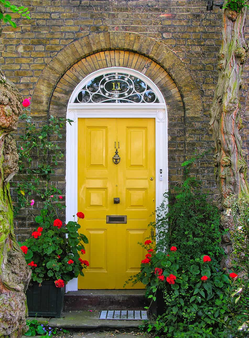 Yellow Door on a Dark Exterior