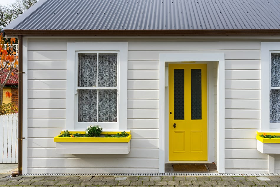 Yellow Door with White Siding