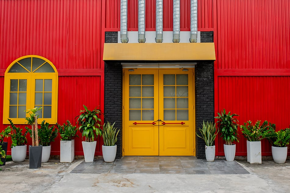 Yellow Double Doors with Bright Red Siding