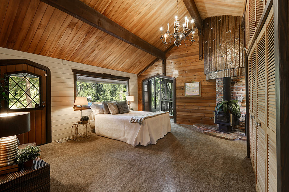High-Vaulted Ceiling in a Rustic Bedroom
