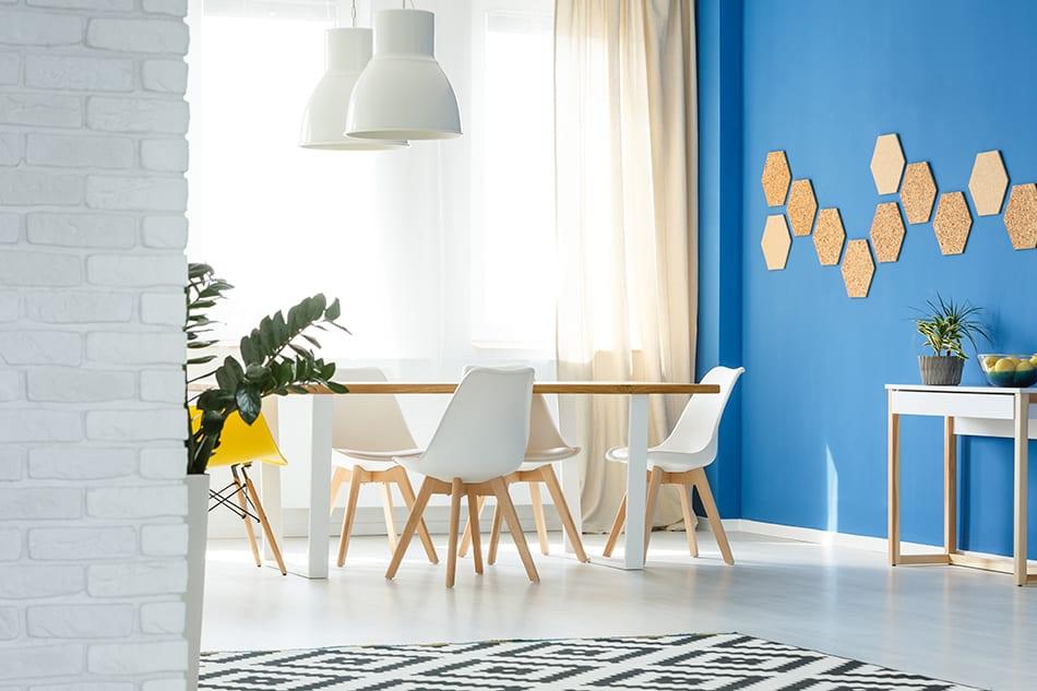 Tan Curtain on Blue Wall