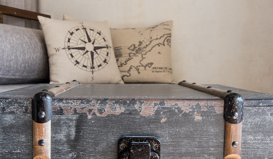 Map on wooden chest and cushions