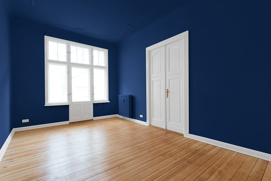 Paint the walls and ceiling with darker colors