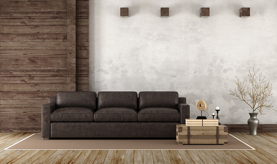 Brown Leather Couch Next to Brown Wall as a Focal Point