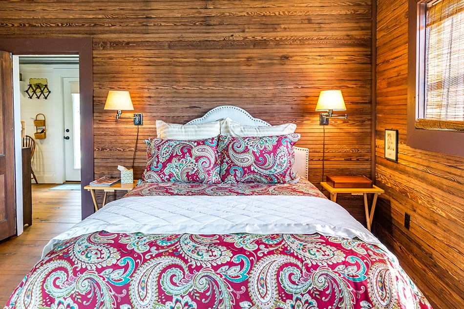 Distressed Wooden Wall Paneling in a Rustic Bedroom