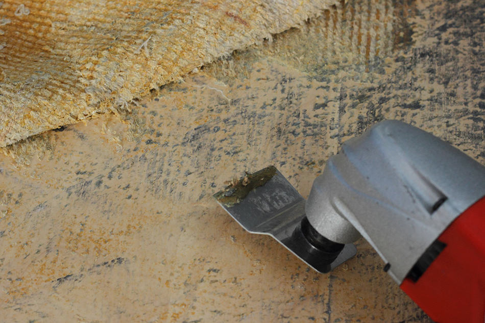 Removing Thinset from Concrete Using Floor Stripper and a Power Chisel