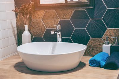 How Far Should the Faucet Extend into the Bathroom Sink?